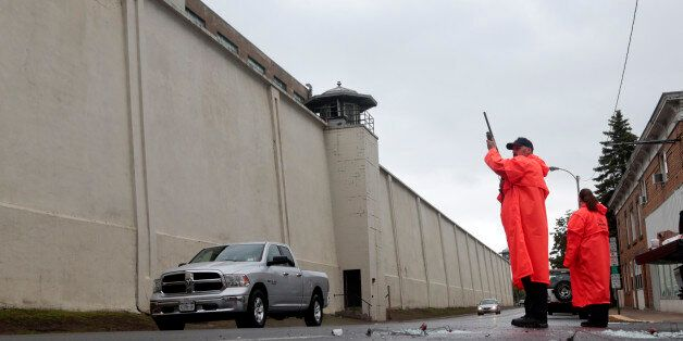 A state corrections officer monitors traffic passing Clinton Correctional Facility on Monday, June 8,...