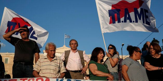 Supporters of Greek Communist party's labor union PAME take part in an anti-austerity rally in front...
