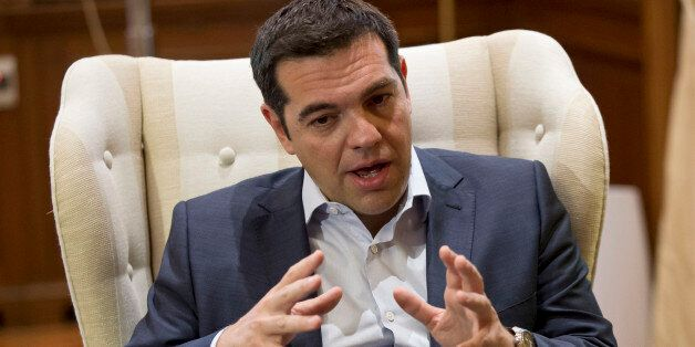 Greek Prime Minister Alexis Tsipras gestures during a meeting with Stavros Theodorakis, leader of the...