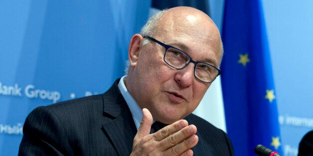 France's Finance Minister Michel Sapin speaks during a news conference after the IMFC meeting at the...
