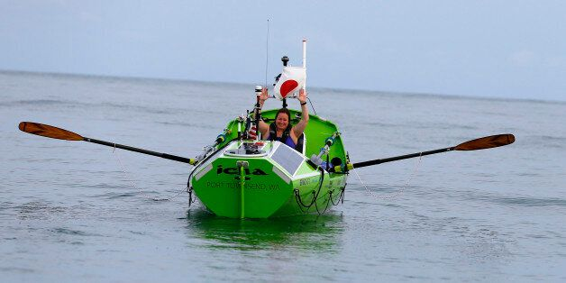 American rower Sonya Baumstein, from Orlando, Fla., waves as she leaves Choshi Marina in Choshi, a port...
