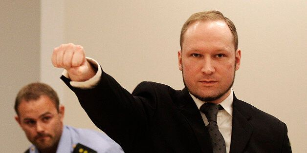 FILE - In this Aug. 24, 2012 file photo, mass murderer Anders Behring Breivik, makes a salute after arriving...
