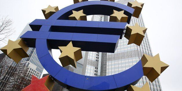 The euro sign sculpture is pictured in front of the building that used to host the headquarters of the...