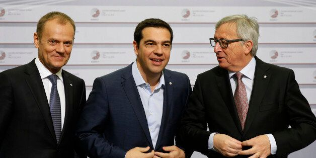 European Commission President Jean-Claude Juncker, right, and Greek Prime Minister Alexis Tsipras, center,...