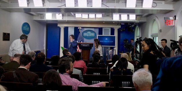 Members of the media enter the White House Briefing Room in Washington, Tuesday, June 9, 2015, to continue...