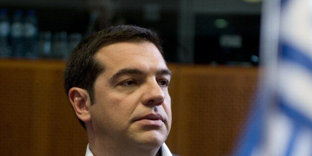 Greece's Prime minister Alexis Tsipras looks on prior to a round table as part of an extraordinary 'EU-CELAC'...