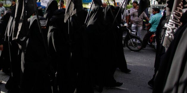 Protest held on 6 September 2014 calling for Islamic Shariah to be implemented in Maldives. Protestors...