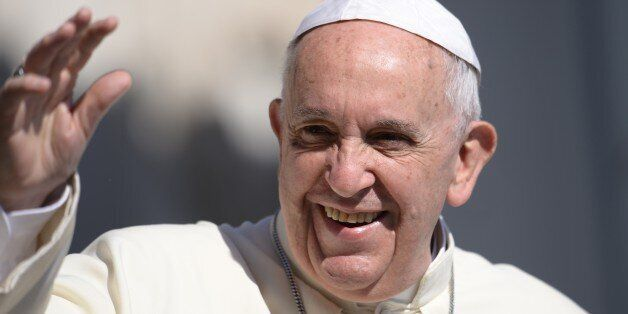 Pope Francis greets the crowd as he arrives for his general audience at St Peter's square on June 10,...