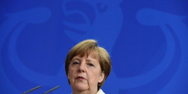 German Chancellor Angela Merkel addresses a joint press conference with Luxemburg's Prime Minister following...