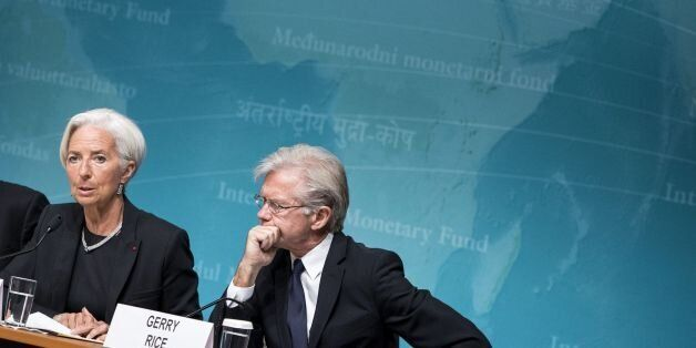 IMF Western Hemisphere Director Alejandro Werner (L) and spokesperson Gerry Rice (R) listen while IMF...