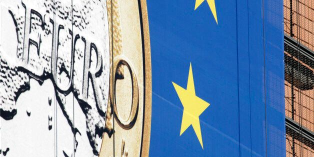 The euro sign is seen on the side of the building of EU headquarters in Brussels on Monday, Feb. 20,...
