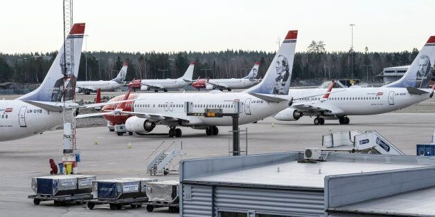 Parked Boeing 737-800 aircrafts belonging to budget carrier Norwegian seen at at Stockholm Arlanda Airport...