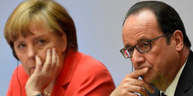 French President Francois Hollande, right, and German Chancellor Angela Merkel attend the Petersberg...