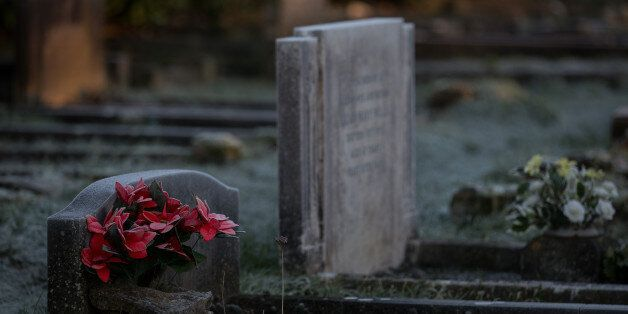 BATH, UNITED KINGDOM - DECEMBER 29: Frost lingers on a headstone in a cemetery near Bath on December...
