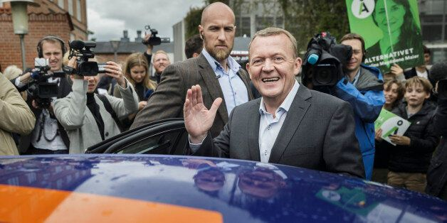 The Danish Liberal Party leader, Lars Loekke Rasmussen, waves to the crowd after casting his vote Thursday,...