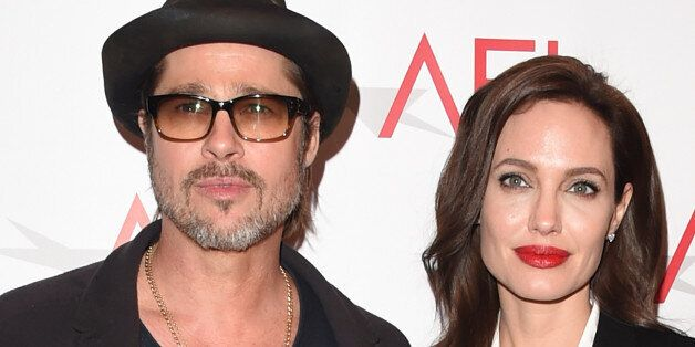 BEVERLY HILLS, CA - JANUARY 09:  Actor Brad Pitt (L) and actress/director Angelina Jolie attend the 15th Annual AFI Awards at Four Seasons Hotel Los Angeles at Beverly Hills on January 9, 2015 in Beverly Hills, California.  (Photo by Jason Merritt/Getty Images)