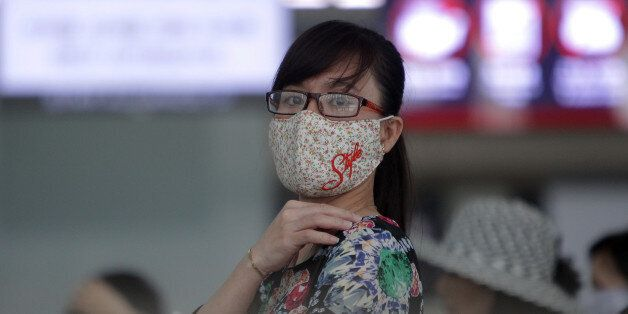 INCHEON, SOUTH KOREA - JUNE 06: A woman wears mask as a precaution against the MERS virus at the Incheon...