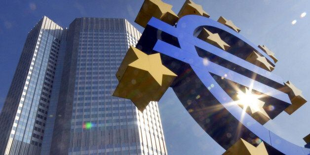 ** FILE ** A Euro sculpture is seen in the autumnal sun in front of the European Central Bank ECB building,...