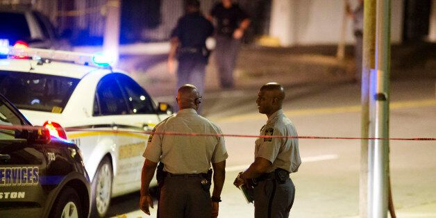 Police stand outside the Emanuel AME Church following a shooting Wednesday, June 17, 2015, in Charleston,...