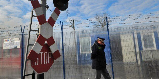 A Romanian border police oficer inspects the Ungheni train station at the border with Moldova on January...