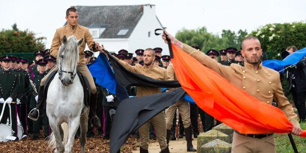 Actors play a symbolic scene during the official Belgian ceremony to commemorate the bicentenary of the...