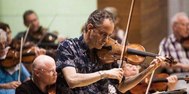 In this photo taken Wednesday, May 27, 2015, Grammy Award-winning American violinist Eugene Drucker,...