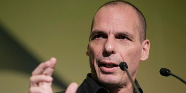 Greek Finance Minister Yanis Varoufakis gives a speech during an economic conference in Athens, on Tuesday,...