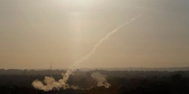 FILE - In this Aug. 9, 2014 file photo, a rocket is fired from Gaza City towards Israel. The human rights...