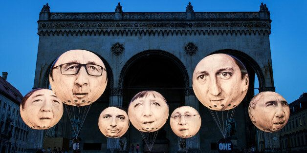 MUNICH, GERMANY - JUNE 5: Activists have installed balloons decorated with the portraits of (L-R) Japanese...