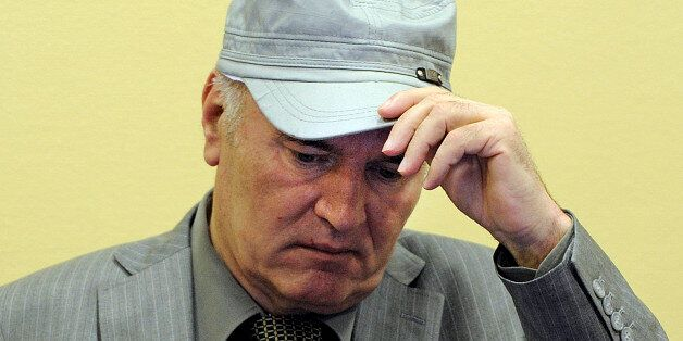 FILE - In this June 3, 2011 file photo, former Bosnian Serb Gen. Ratko Mladic removes his hat in the...