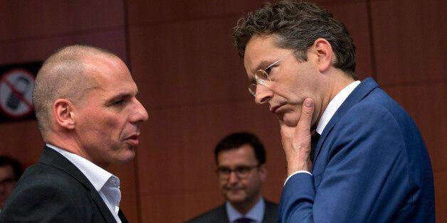 Greek Finance Minister Yanis Varoufakis, left, speaks with Dutch Finance Minister Jeroen Dijsselbloem...