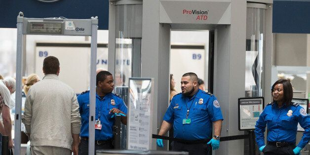 CHICAGO, IL - JUNE 02: Travelers are screened by Transportation Security Administration (TSA) workers...