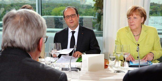 (L-R) European Commission President Jean-Claude Juncker, French President Francois Hollande and German...
