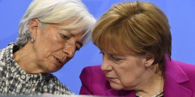 (From L) International Monetary Fund Managing Director Christine Lagarde and German Chancellor Angela...