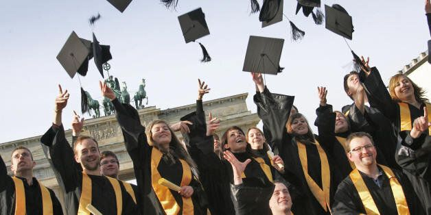 Graduates of the private 'International Business School Berlin' (IBS) throw their doctoral caps in the...