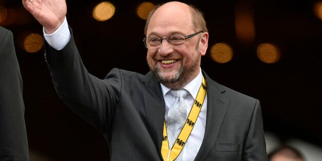 European parliament president Martin Schulz waves after he received the International Charlemagne Prize...