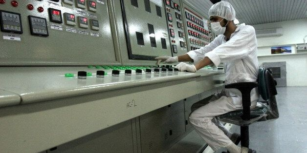 FILE - In this Saturday, Feb. 3, 2007 file photo, an Iranian technician works at the Uranium Conversion...