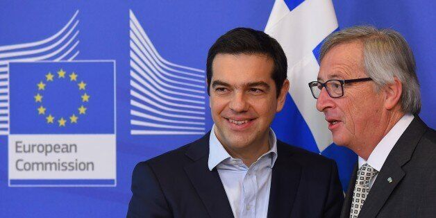 Greece's Prime Minister Alexis Tsipras (L) is welcome by European Commission President Jean-Claude Juncker...