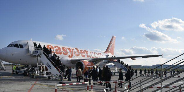 People board an Easy Jet plane on March 17, 2015 at the Toulouse-Blagnac airport in the southwestern...