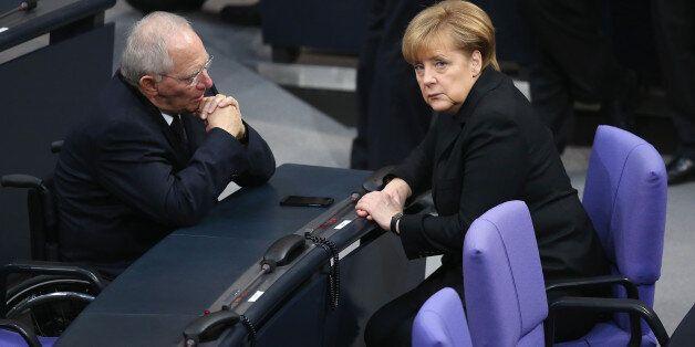 BERLIN, GERMANY - DECEMBER 17: German Chancellor Angela Merkel (R) and Finance Minister Wolfgang Schaeuble...
