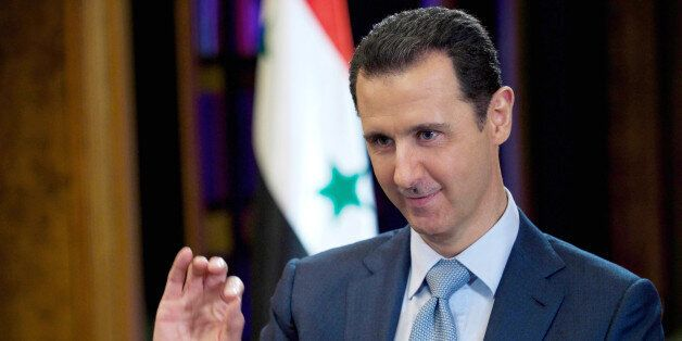 FILE - In this Tuesday, Feb. 10, 2015 file photo released by the Syrian official news agency SANA, Syrian...