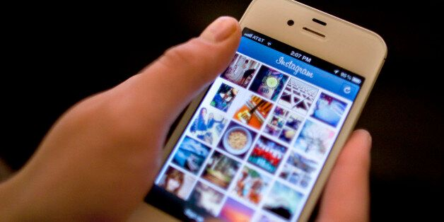 Instagram is demonstrated on an iPhone Monday, April 9, 2012, in New York. Facebook is spending $1 billion...