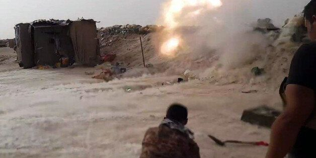 In this image taken Friday, May 29, 2015, Iraqi anti-terrorism forces battle with Islamic State group...