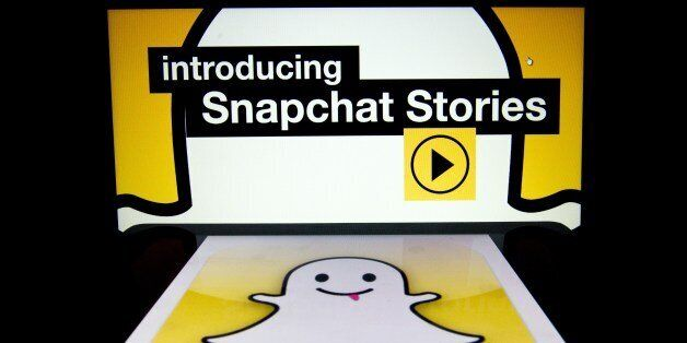 The logo and a page of mobile app 'Snapchat' are displayed on tablets on January 2, 2014 in Paris. Hackers...