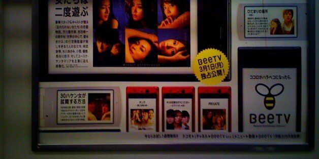 "It seems the Japanese advertisers and marketing people want to keep me busy. Ok this poster on the metro is about BeeTV, it seems to be some kind of television network specialized in cell phone. So basically you can watch some bunch of films, drama (series) on your phone while you are in train. Which leads me to the odd stuff, if you take a look a the third fake cell phone screen capture on the bottom, you can see two gorgeous ladies and the title of the content is ""Private"" hmmm . Plus to for the fact the two ladies are not Asiatic types(that's only westerners faces on the whole poster).It is clear that corner is about ""adult entertainment"". Ok fair enough,  after all normal cable networks have also dozen of those but where it is getting awkward it's like this company is selling content for cell phone. So it means the guys who made the ad are kind of saying ""hey why don't you watch a porn on the train or in the taxi"". See my point ..."