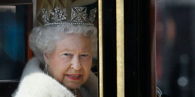 Britain's Queen Elizabeth II travels in a carriage from Buckingham Palace towards the Houses of Parliament...