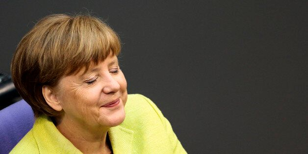 German Chancellor Angela Merkel smiles as she attends a debate about the European Union and an Eastern...