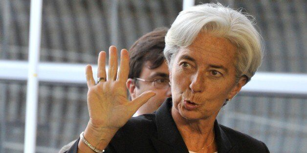 French Finance Minister Christine Lagarde waves as she arrives prior to an Eurogroup meeting on June...