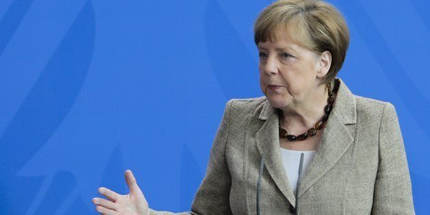 German Chancellor Angela Merkel, right, and British Prime Minister David Cameron brief the media after...