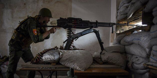 A Russia-backed rebel aims a machine gun on the outskirts of Donetsk, eastern Ukraine, Tuesday, May 26,...
